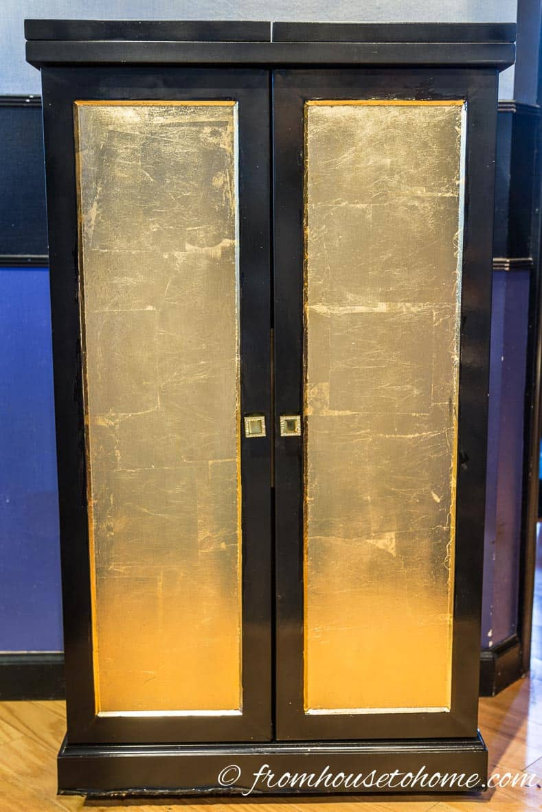 Black lacquer cabinet with gold leaf on the door fronts
