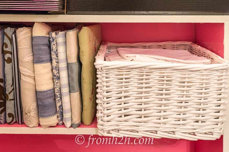 The basket of lining fits perfectly on the shelf beside the wrapped fabric