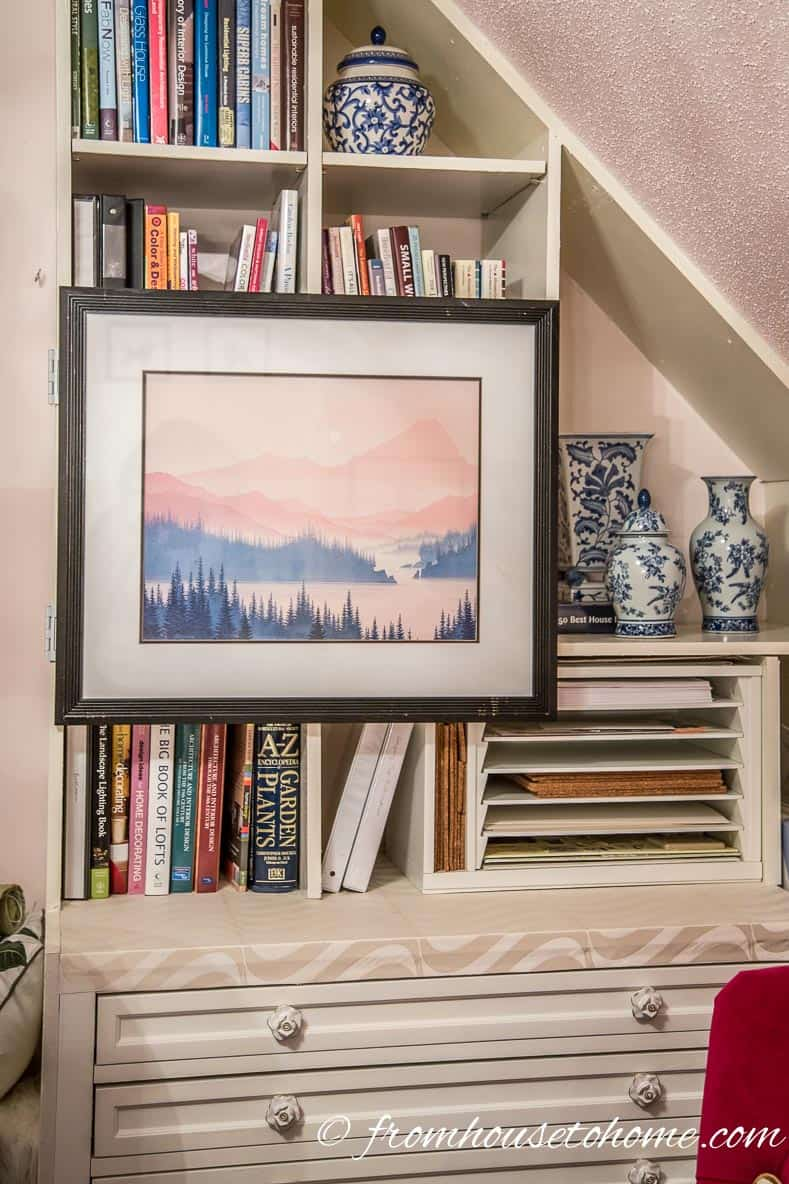 The finished picture | How To Hang Art On A Bookcase (And Still Have Easy Access To The Books)