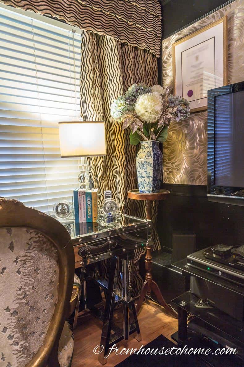 A black TV stand helps to camouflage the electronics   How to Make Your Desk More Comfortable