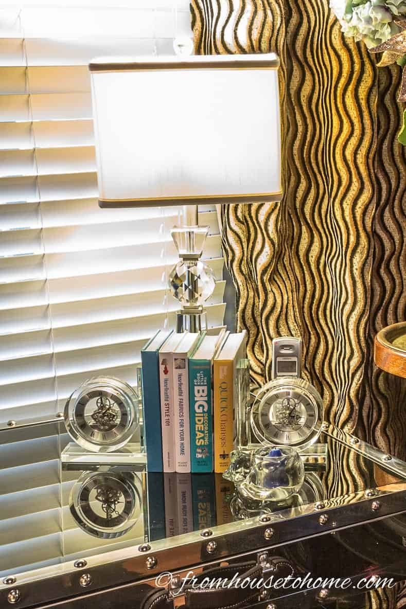 A lamp provides lighting on a home office desk
