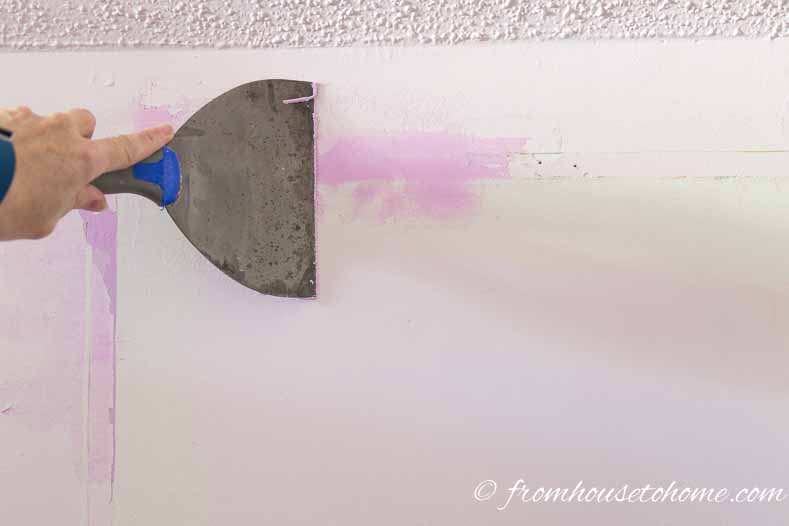 Fill any holes with spackle | How To Hang Wallpaper The Easy Way