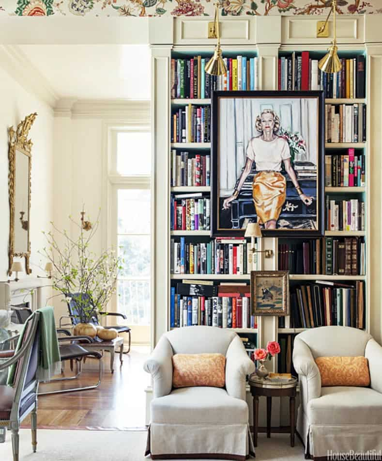 Art hung on a bookcase. Design by Alex Hitz. Photography by Lisa Romerein. Via housebeautiful.com | How To Hang Art On A Bookcase and Still Have Easy Access To The Books