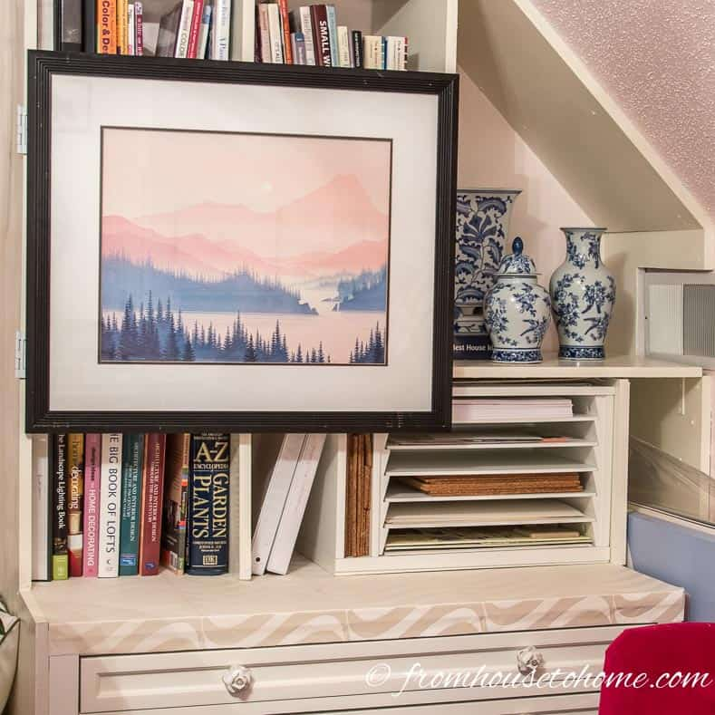 How To Hang Art On A Bookcase (And Still Have Easy Access To The Books)
