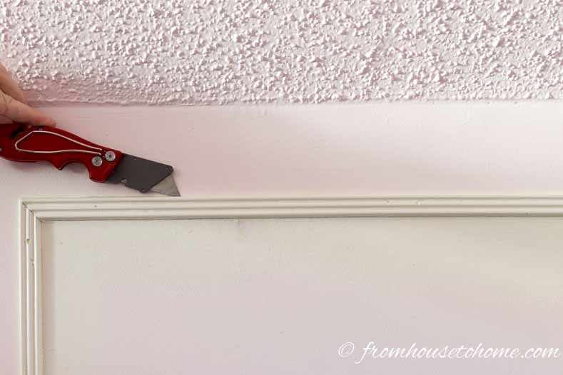 Split the caulking with a utility knife
