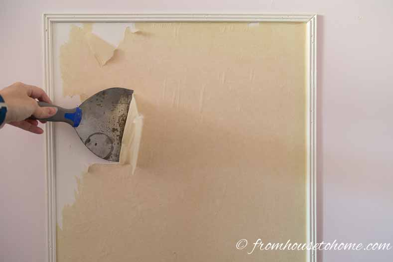 Use a scraper to help loosen the paper | 3 Secrets For Hanging Wallpaper So It Can Be Removed Easily