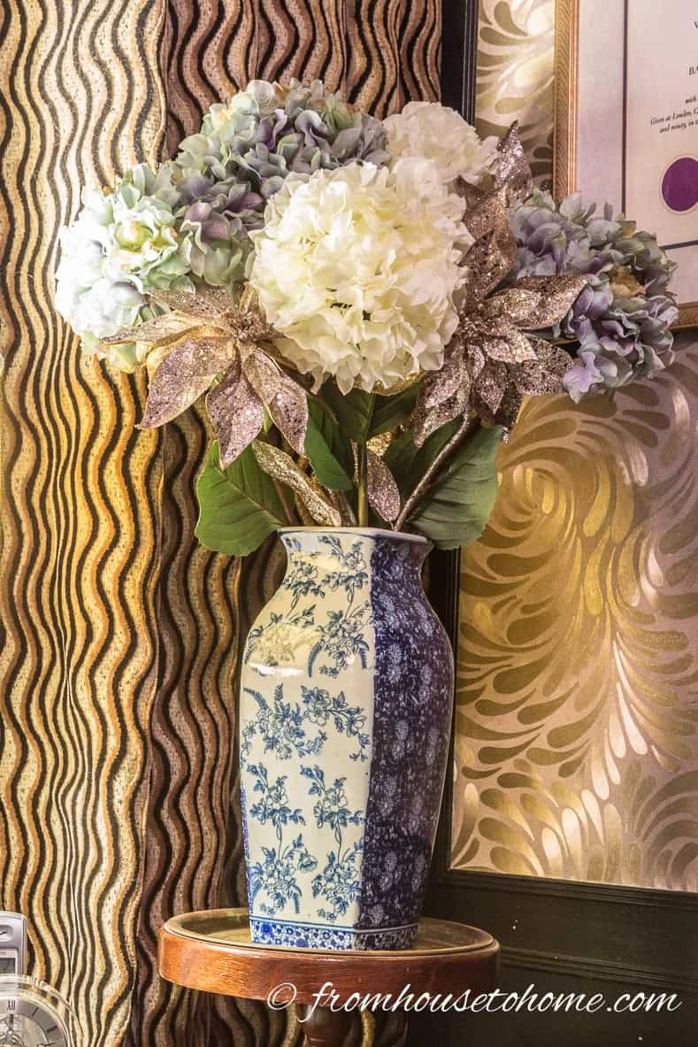 A large vase with flowers adds color in the corner (even if they are fake) | How to Make Your Desk More Comfortable