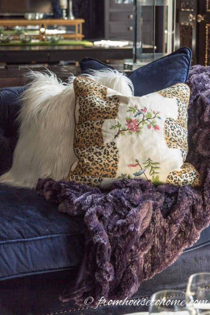 Faux fur cushion and embroidered fabric cushion on a sofa
