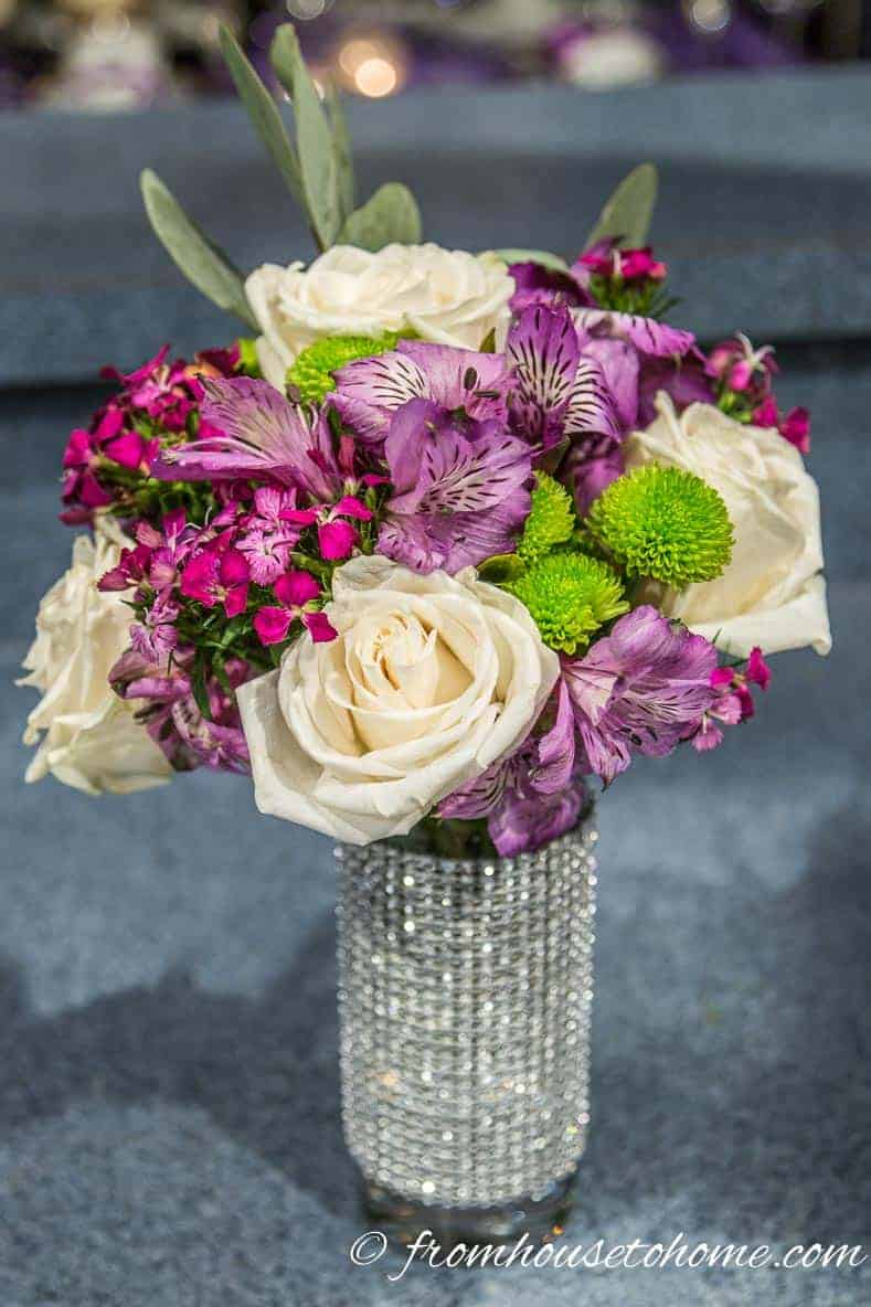 Flowers in a highball glass are an easy and inexpensive centerpiece