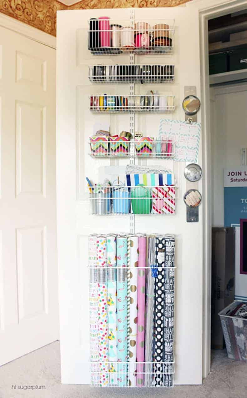 Behind the door gift wrap storage center via iheartorganizing.com