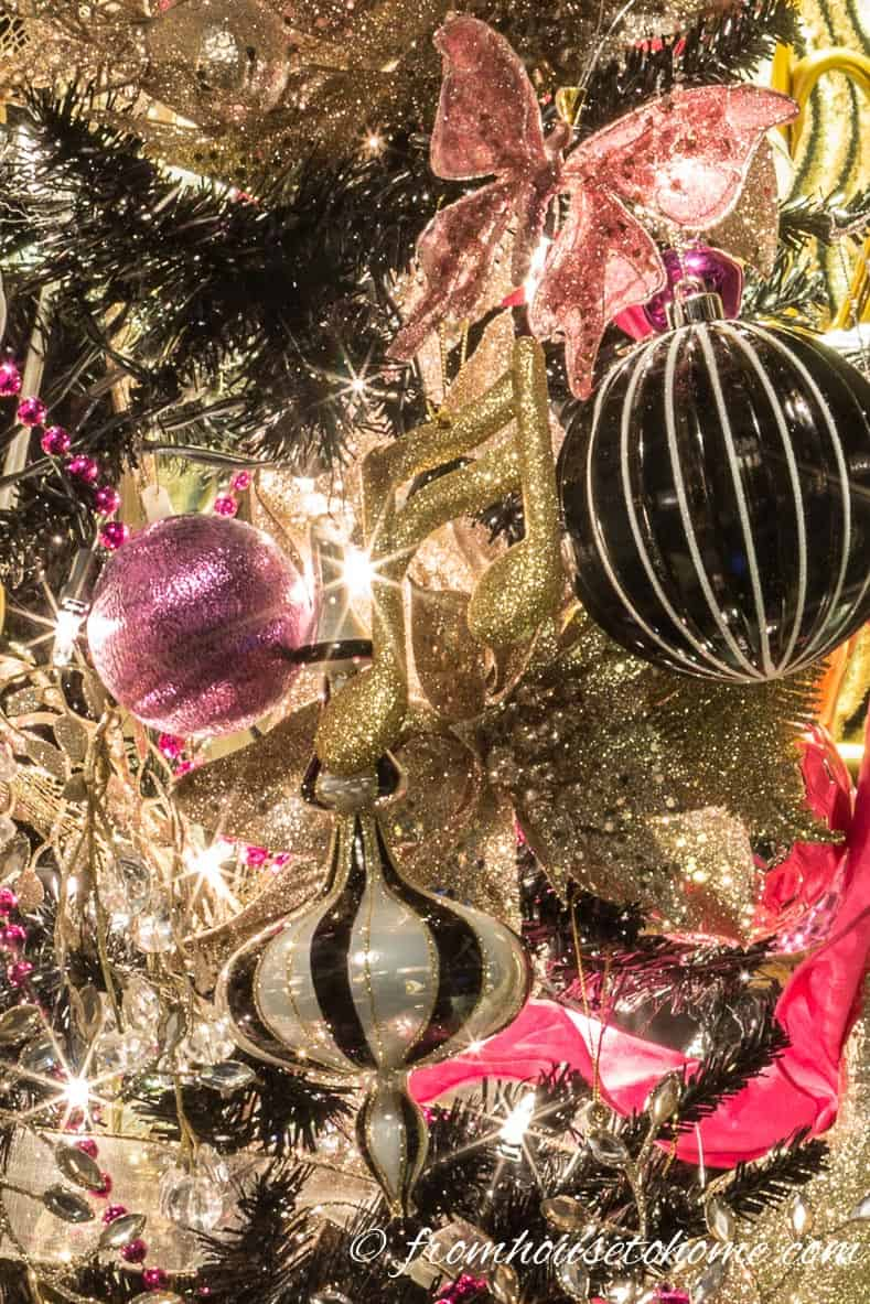 The black, white and pink ornaments | Looking for some glam gold Christmas tree ideas with a splash of pink? Learn how to decorate a Kate Spade inspired Christmas tree with these step-by-step instructions (and sources).