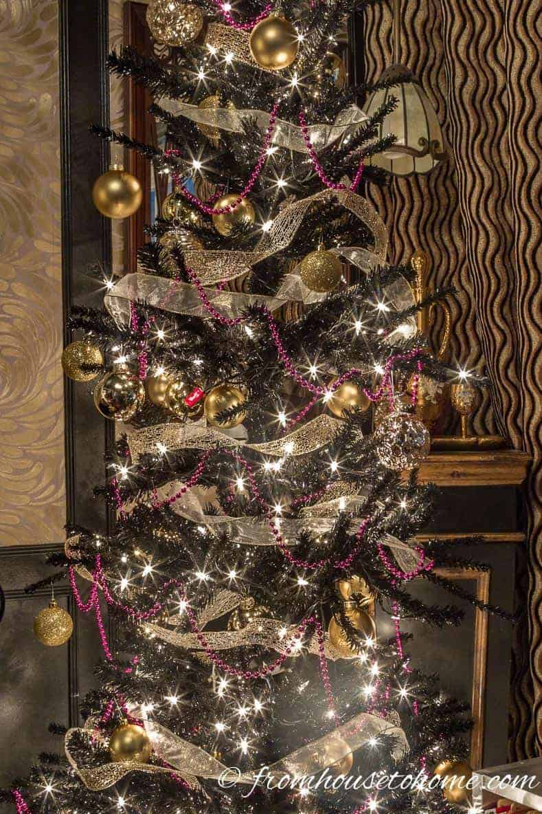Add gold ornaments | Looking for some glam gold Christmas tree ideas with a splash of pink? Learn how to decorate a Kate Spade inspired Christmas tree with these step-by-step instructions (and sources).