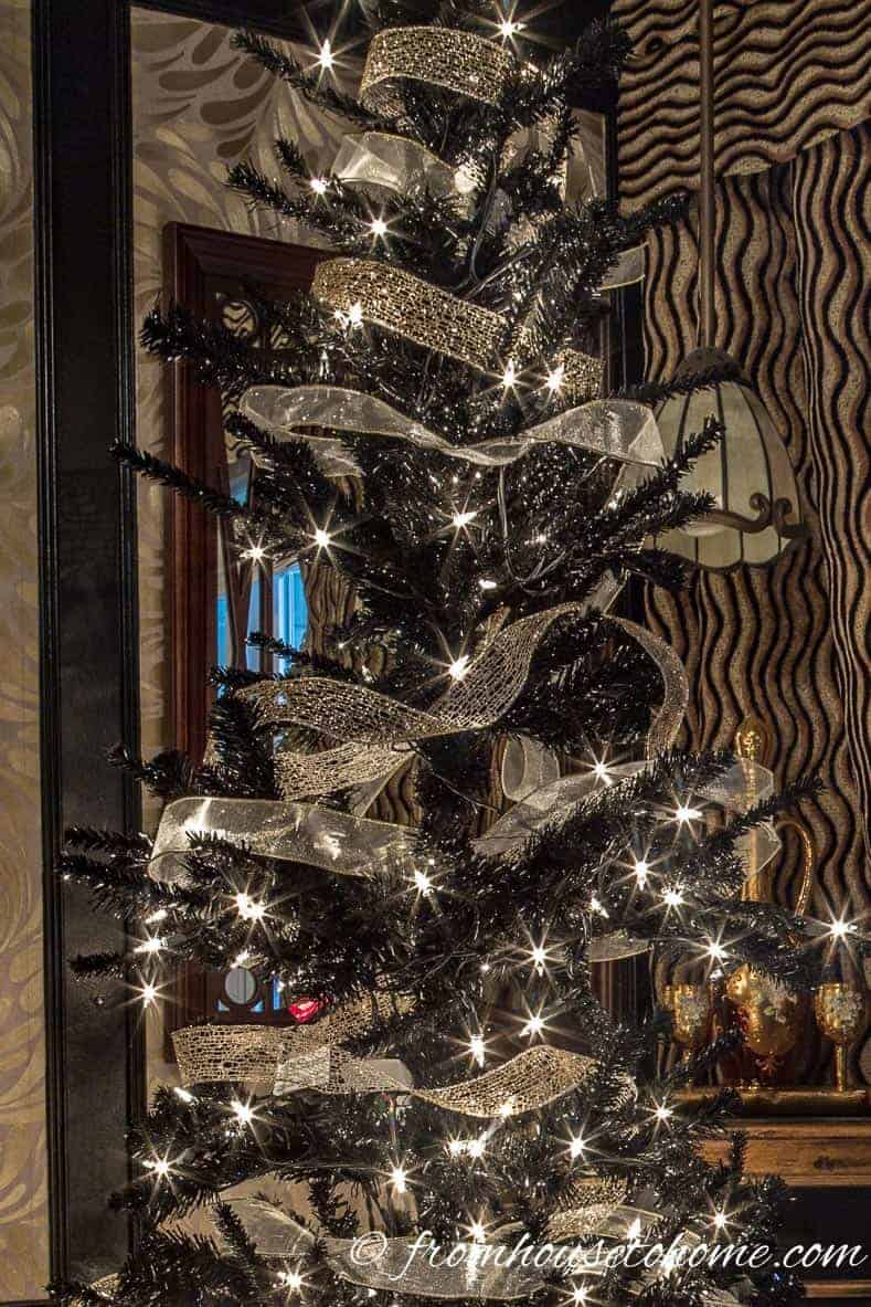 Wrap gold ribbon around the tree | Looking for some glam gold Christmas tree ideas with a splash of pink? Learn how to decorate a Kate Spade inspired Christmas tree with these step-by-step instructions (and sources).