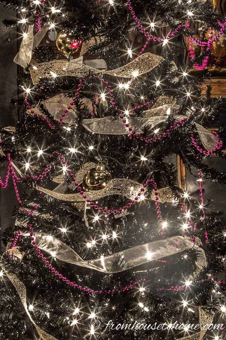 Add pink garland | Looking for some glam gold Christmas tree ideas with a splash of pink? Learn how to decorate a Kate Spade inspired Christmas tree with these step-by-step instructions (and sources).