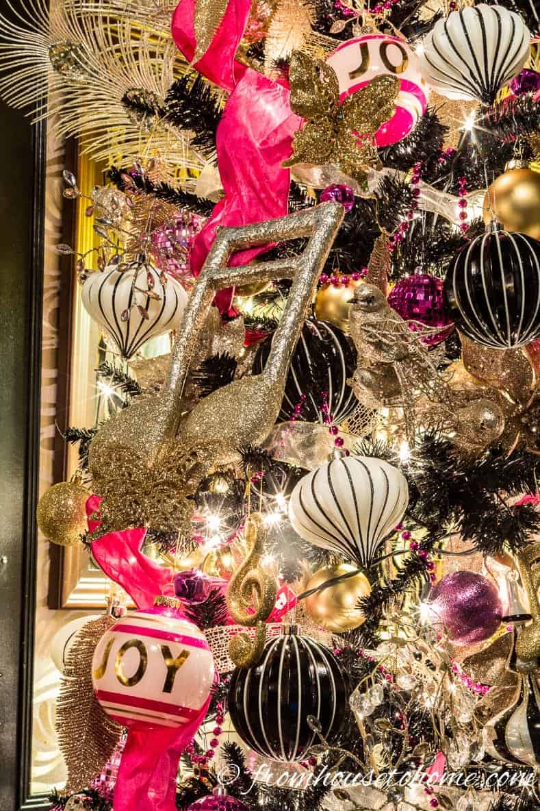 Music ornaments | Looking for some glam gold Christmas tree ideas with a splash of pink? Learn how to decorate a Kate Spade inspired Christmas tree with these step-by-step instructions (and sources).