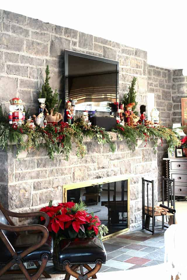 Taller Christmas decorations on either side of the TV help to incorporate it into the design via niagaranovice.blogspot.com | How To Decorate a Christmas Mantel With a TV Above It