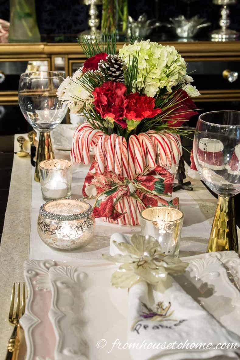 The centerpiece on the table | Learn how to add some Christmas spirit to your table with a DIY candy cane centerpiece! | DIY Quick and Easy Candy Cane Centerpiece