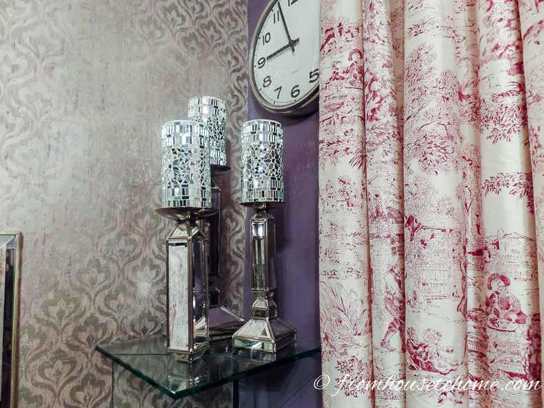 Silver candles on mirrored candlesticks