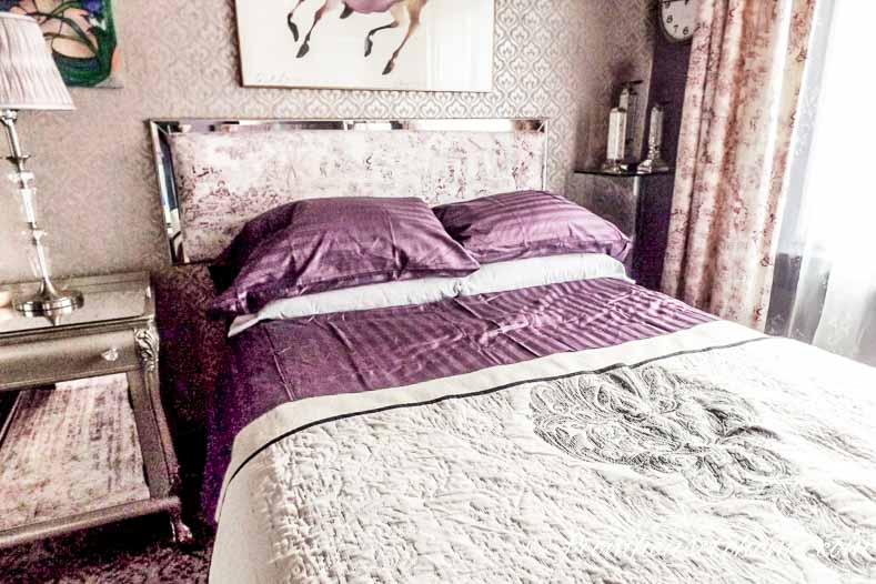 Purple sheets on the bed