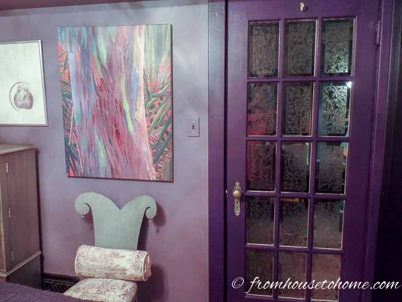 Purple bedroom walls with woodwork painted a darker purple