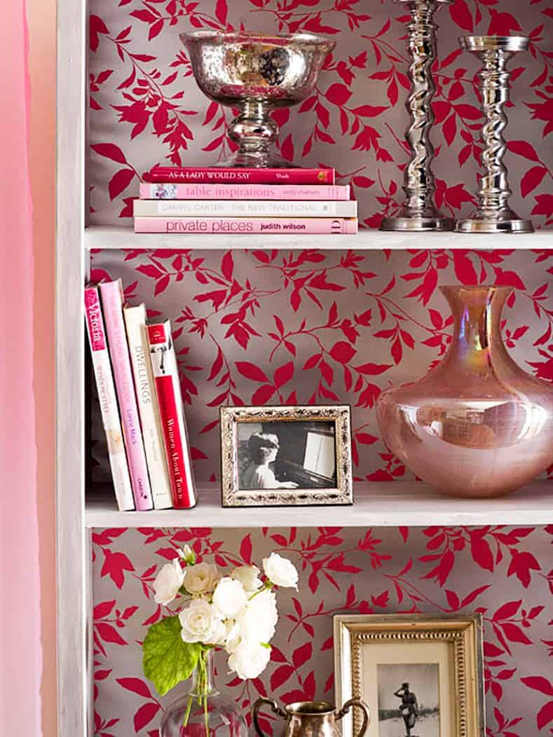 Bookshelves with the back covered in wallpaper