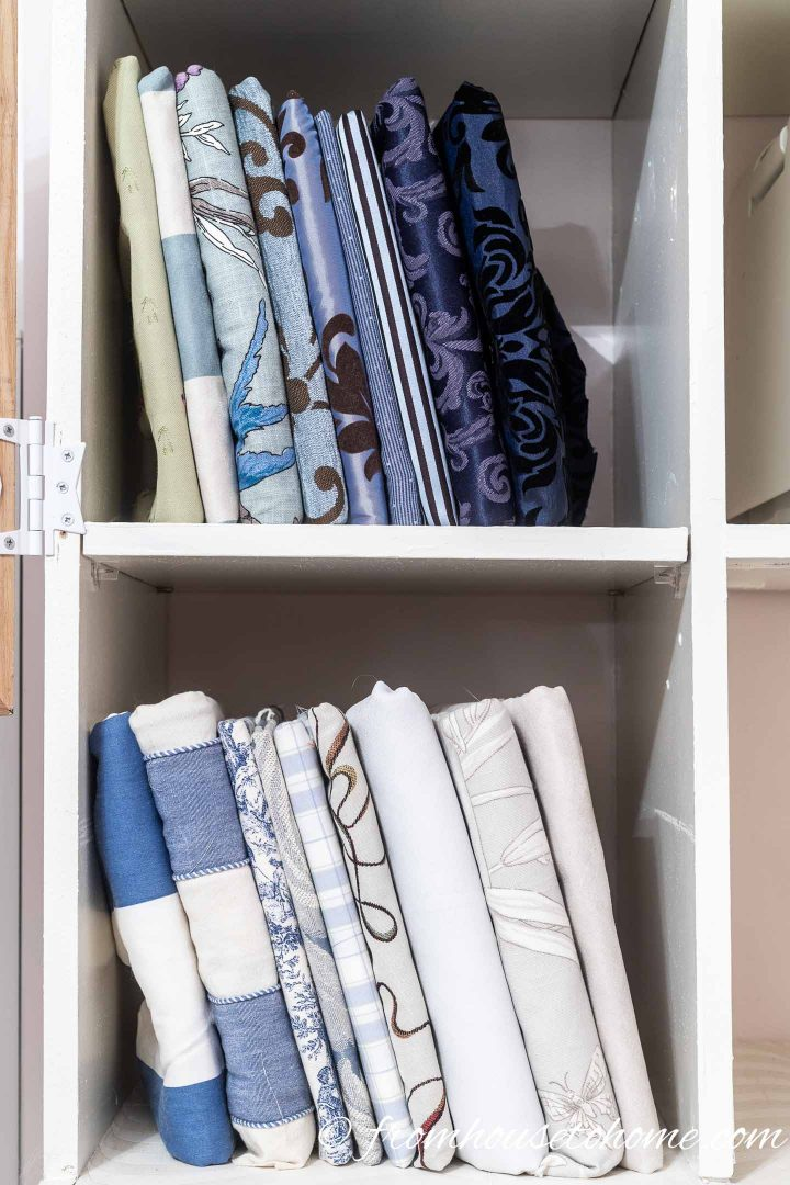 Fabric wrapped around cards stored on a craft room shelf