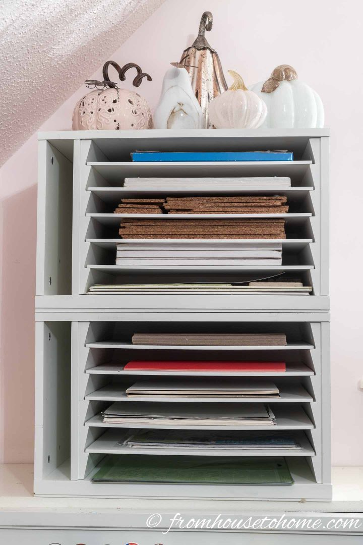 Paper, cork board, adhesive vinyl, Cricut mats and other craft room supplies stored in a paper organizer