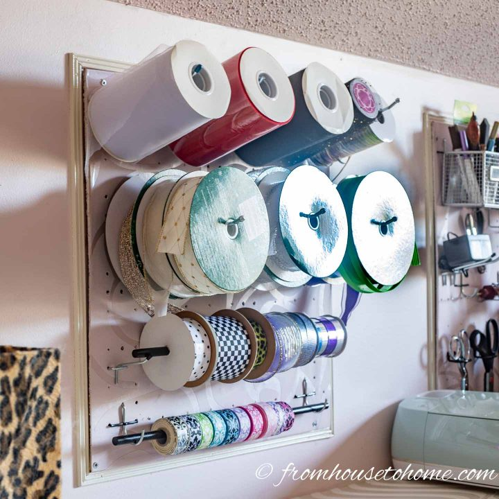Ribbon hung on a pegboard for craft room organization
