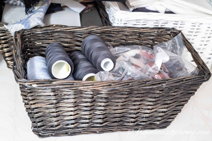 Large rolls of thread stored in baskets help to keep the sewing room organized