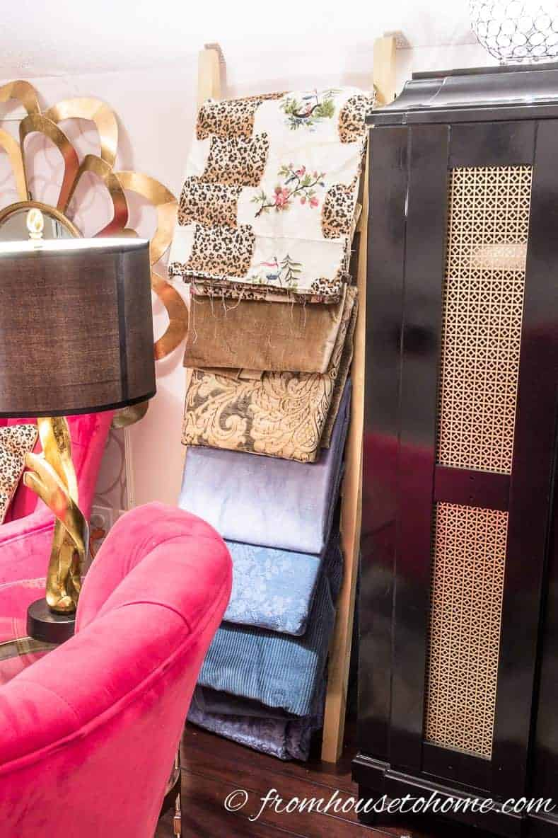 Use an accessories ladder for storing folded fabric | 10 Simple Craft Room Organization and Storage Ideas | If you're looking for easy ways to organize your crafting supplies on a budget, these DIY storage and organization tips and ideas are perfect.