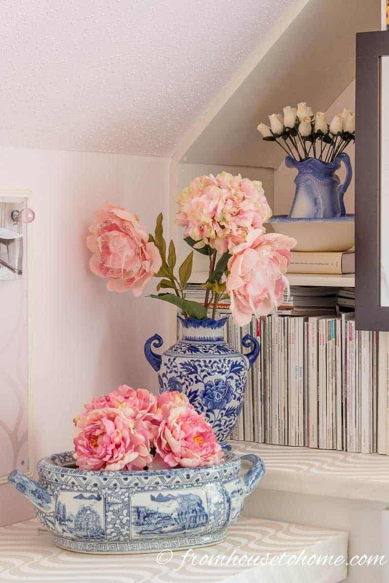 Store faux flowers in vases | 10 Simple Craft Room Organization and Storage Ideas | If you're looking for easy ways to organize your crafting supplies on a budget, these DIY storage and organization tips and ideas are perfect.