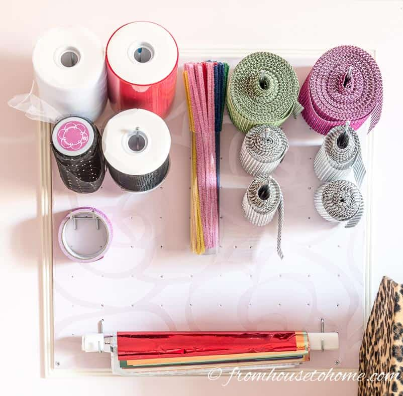 Long straight hooks are good for storing ribbon on pegboard | 10 Simple Craft Room Organization and Storage Ideas | If you're looking for easy ways to organize your crafting supplies on a budget, these DIY storage and organization tips and ideas are perfect.