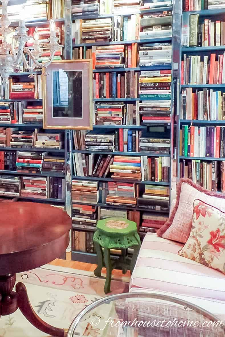 Lay some books flat and stand others up to add interest to book shelves | Room Design Ideas: 7 easy ways to decorate like a design pro | I have used these easy and inexpensive home decorating ideas many times to create rooms that look like a designer decorated them. They are perfect if you are on a budget but still want elegant interior design.