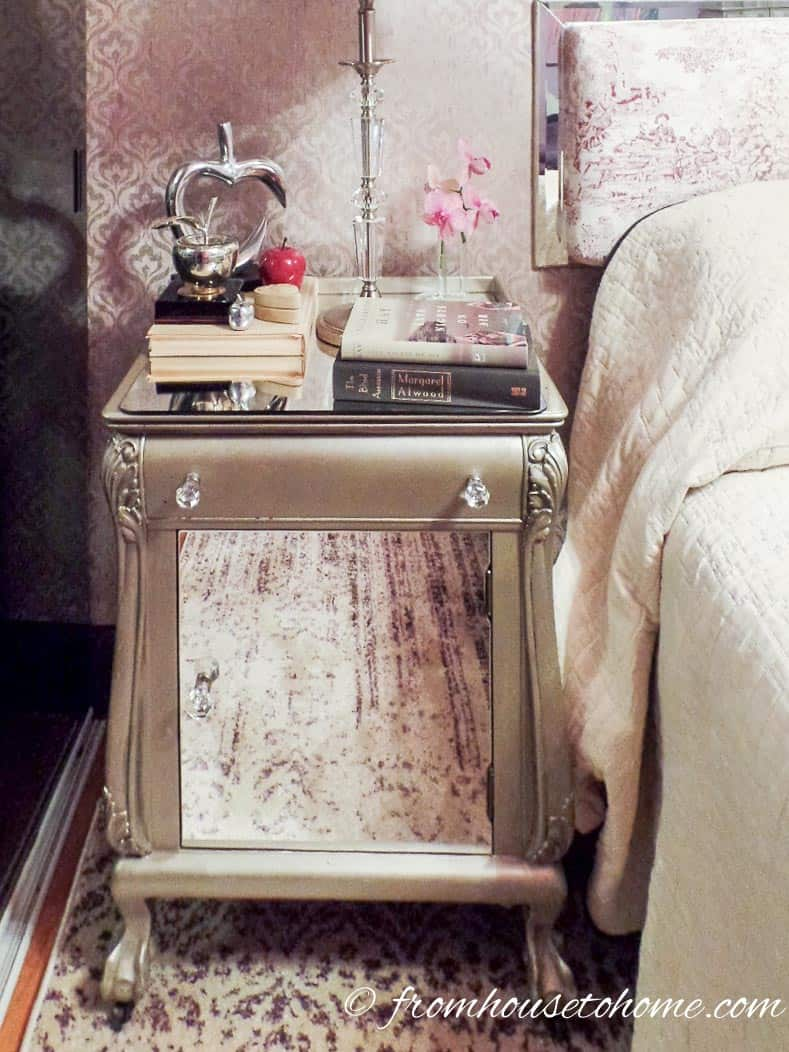 Glue a piece of mirror to the front and top of a night stand