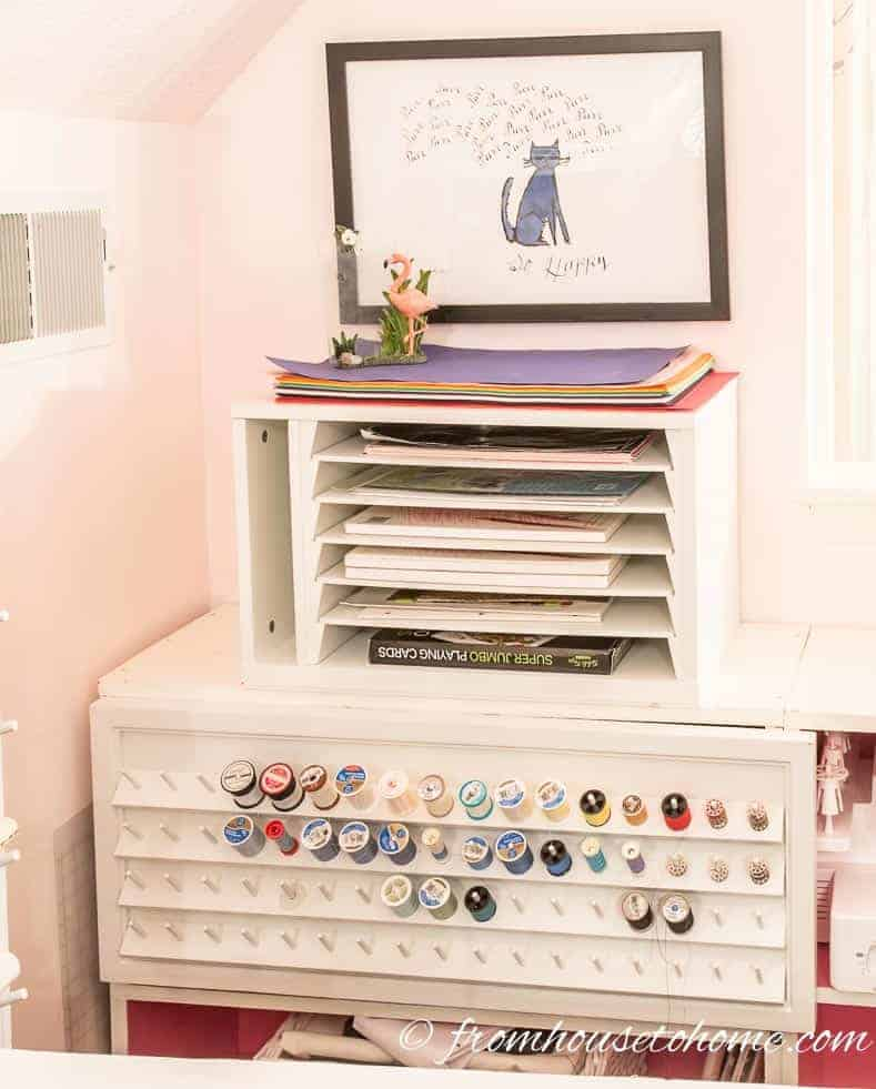 Using a spook rack as a shelf door serves double duty | Home Office Design Ideas: 8 Tips For A Functional and Comfortable Room | If you are looking for some home office design ideas, these tips will give you inspiration to create a functional and comfortable workspace layout.