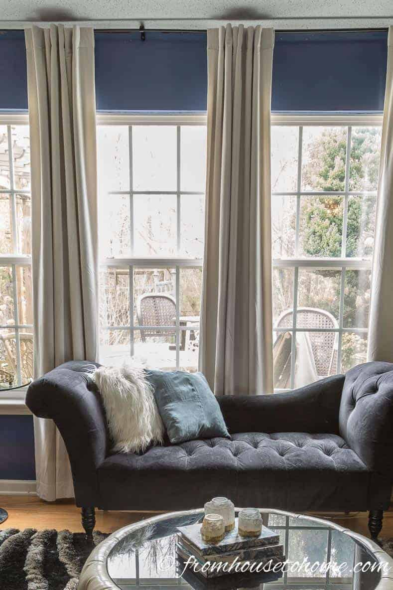 Installing curtains that go from floor to ceiling gives a room that designer feeling | Room Design Ideas: 7 easy ways to decorate like a design pro | I have used these easy and inexpensive home decorating ideas many times to create rooms that look like a designer decorated them. They are perfect if you are on a budget but still want elegant interior design.