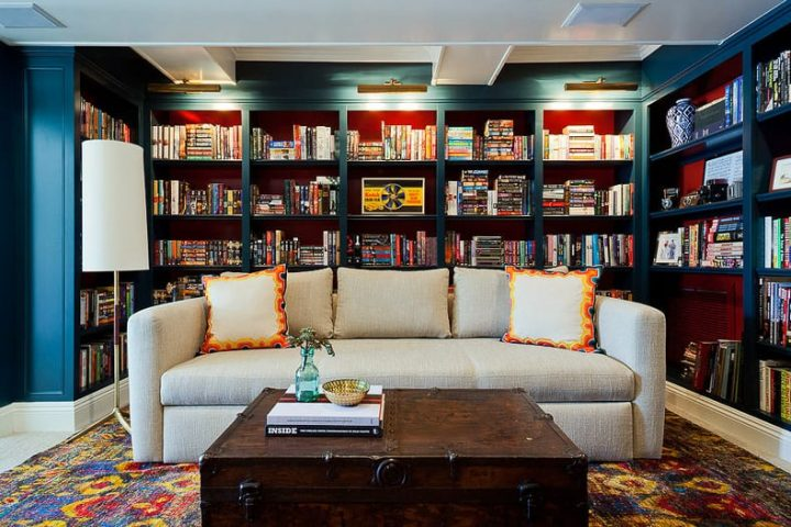 Small library with a large sofa and coffee table