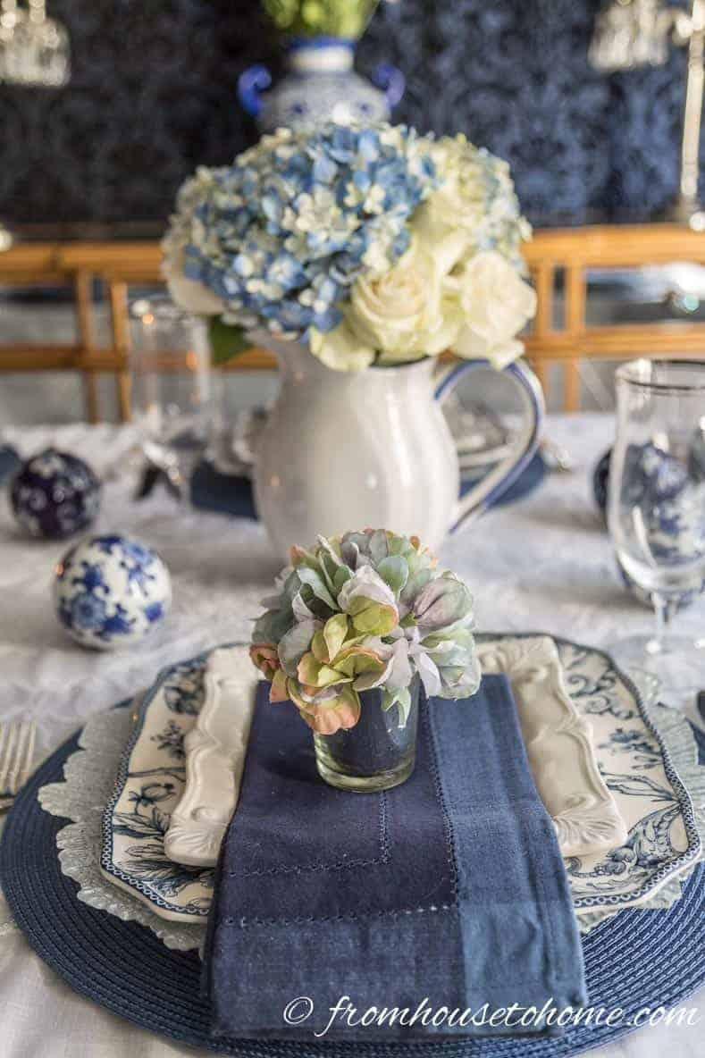 Hydrangea napkin ring in a votive candle holder used as a faux flower place setting
