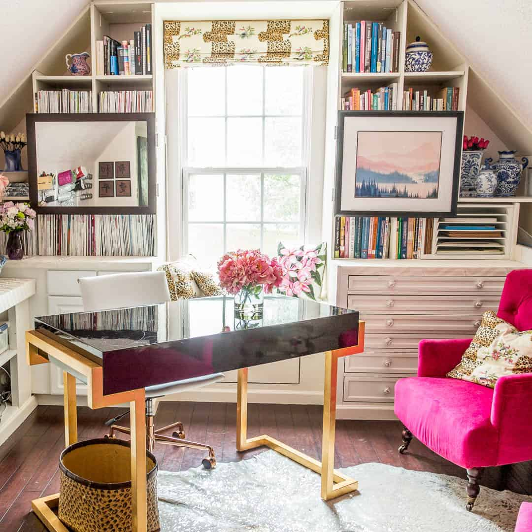 Desk facing into the room in a pink and white home office