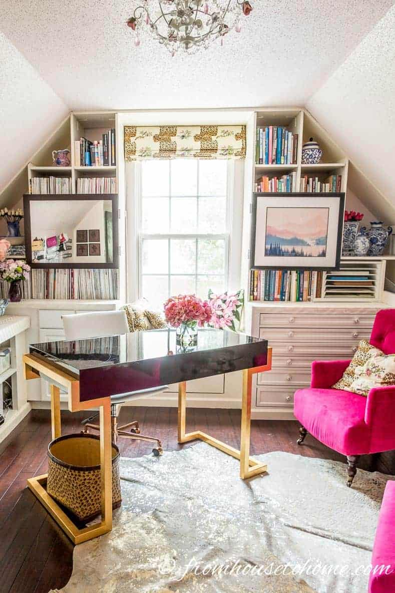Home office with DIY bonus room bookshelves and window bench