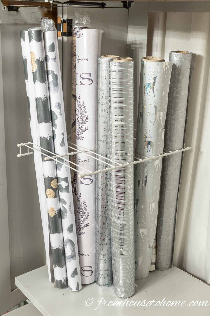 Cut holes in wire shelves to store wrapping paper | 7 clever wire shelving hacks that will get you organized | If you are looking for some DIY wire shelving hacks that are easy and inexpensive, this list of organization ideas will help you to repurpose those wire shelves.