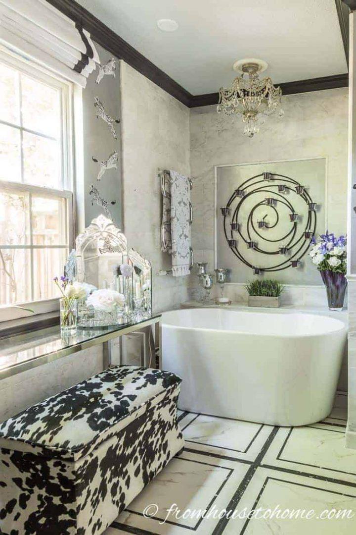 Crown moldings painted black in a silver bathroom