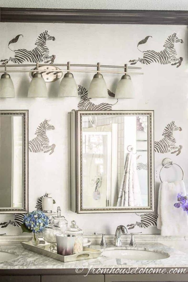 Bathroom wall painted with zebras on a silver background