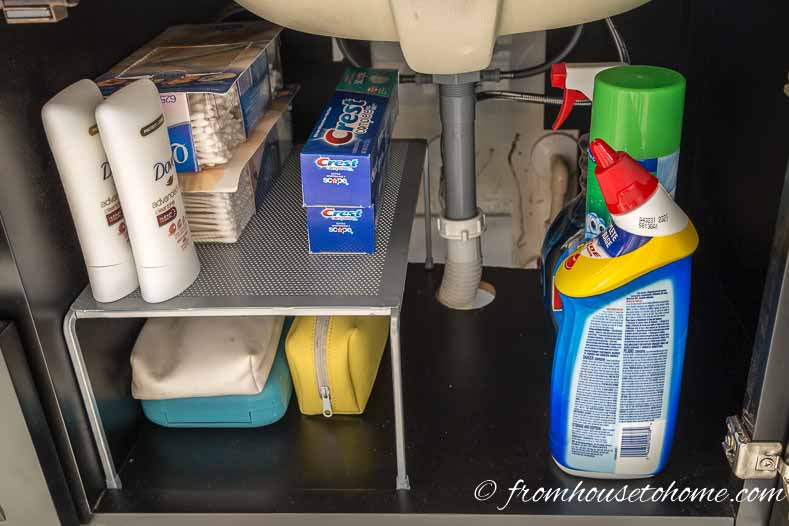 Under sink storage | Bathroom Organization Ideas: 11 Quick and Easy Ways to Clear Clutter | I finally got my master bathroom organized with these bathroom organization ideas. These quick and easy storage tips really help to clear clutter from under the sink, on countertops, in drawers and more.