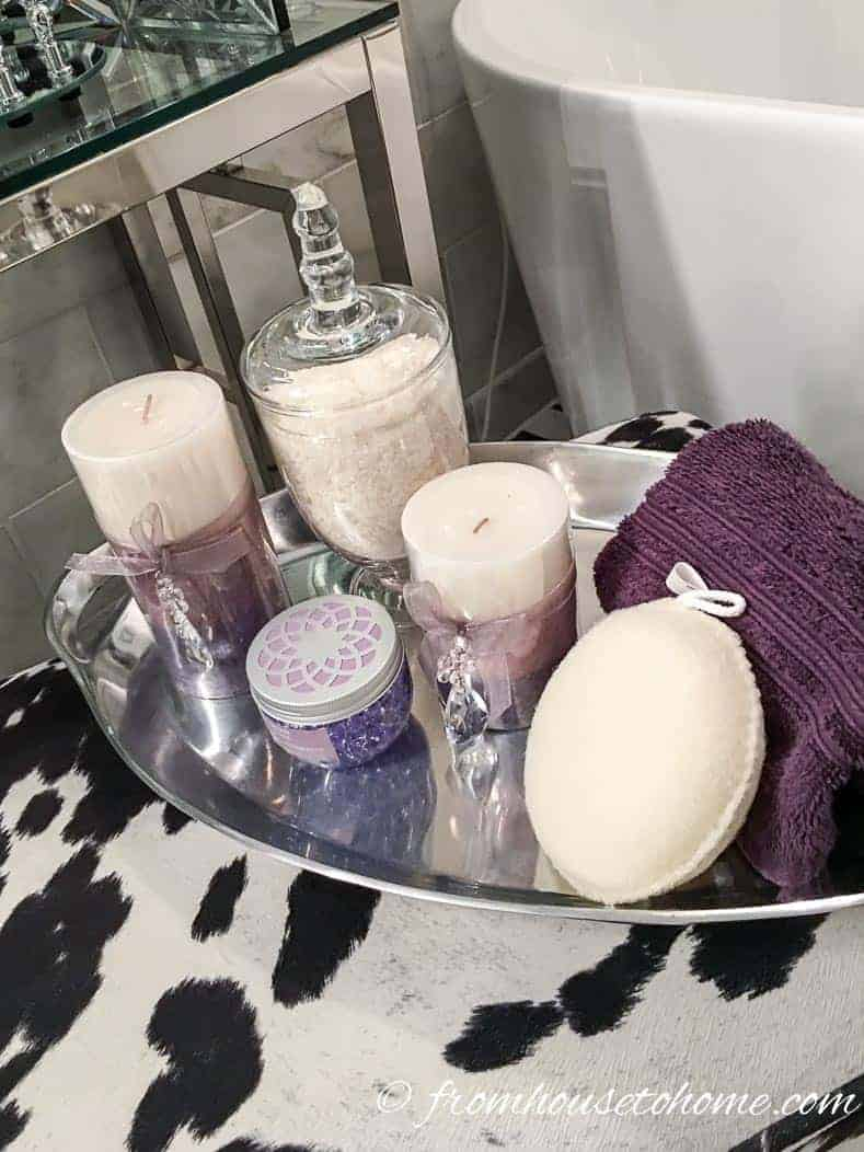 Bath tray with candles, soaps and face cloth