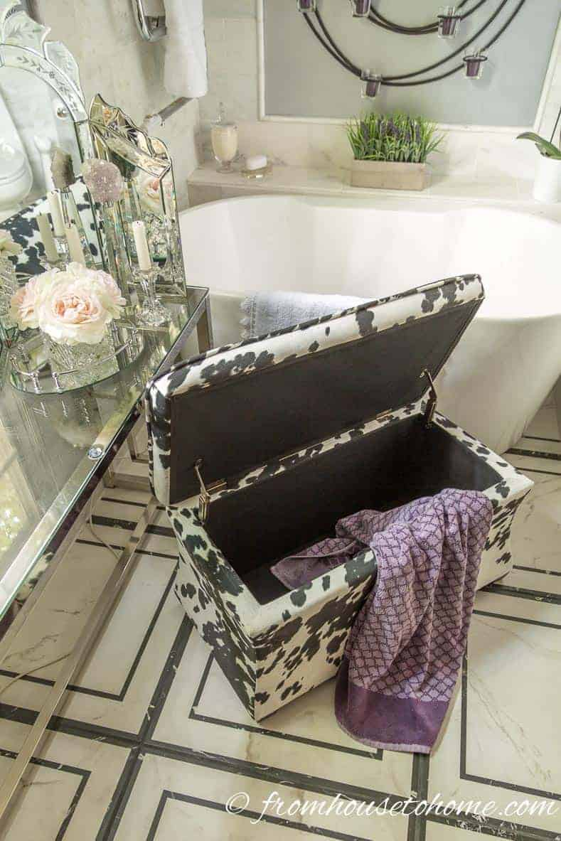 Storage bench as laundry hamper | Bathroom Organization Ideas: 11 Quick and Easy Ways to Clear Clutter | I finally got my master bathroom organized with these bathroom organization ideas. These quick and easy storage tips really help to clear clutter from under the sink, on countertops, in drawers and more.