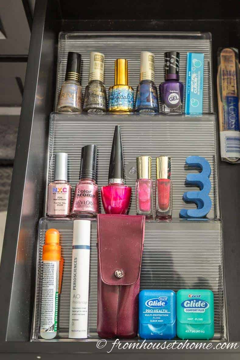 In drawer spice rack for nail polish | Bathroom Organization Ideas: 11 Quick and Easy Ways to Clear Clutter | I finally got my master bathroom organized with these bathroom organization ideas. These quick and easy storage tips really help to clear clutter from under the sink, on countertops, in drawers and more.