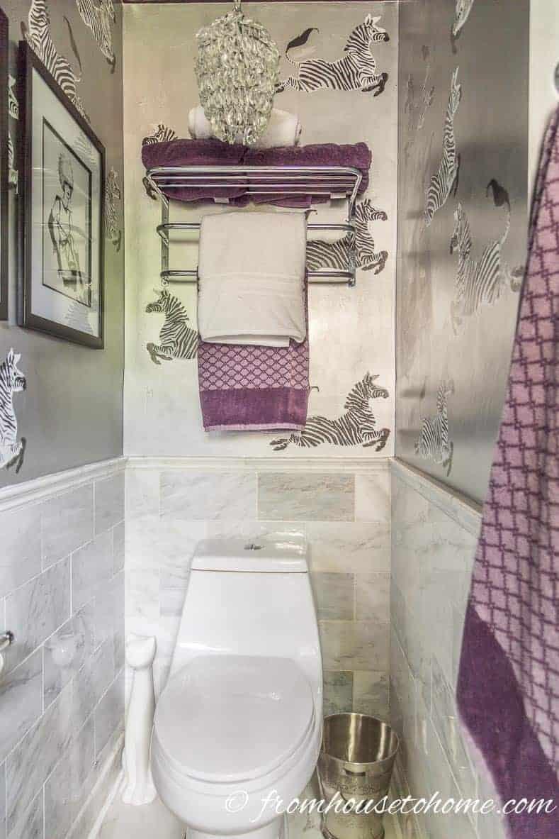 Toilet brush holder beside the toilet