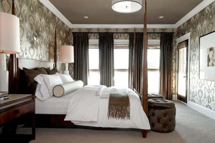 Bedroom with the ceiling painted brown to match the wallpaper
