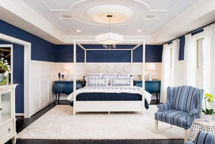 Blue and white bedroom with moldings on the ceiling